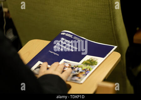 New York, NY, USA. 17th June, 2019. United Nations, UN headquarters in New York. 17th June, 2019. A journalist holds a copy of the World Population Prospects 2019: Highlights, at the UN headquarters in New York, on June 17, 2019. The world's population is expected to increase by 2 billion in the next 30 years, from 7.7 billion currently to 9.7 billion in 2050, according to a United Nations report released here on Monday. Credit: Xinhua/Alamy Live News - Stock Photo