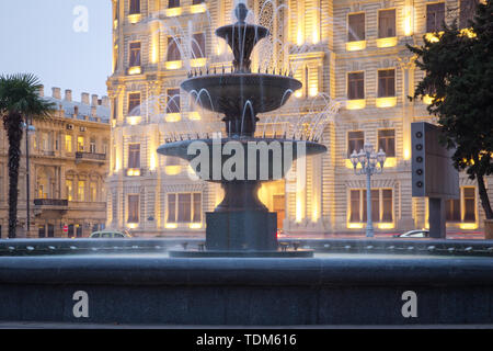 The fountain in the city center. Baku Azerbaijan . night vision of a round park Fountains square - Stock Photo
