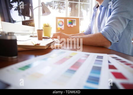 Graphic design and color swatches and pens on a desk. Architectural drawing with work tools and accessories - Stock Photo