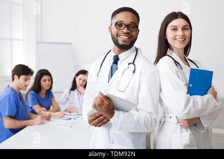 Diverse Professional Doctors In White Coats Posing To Camera At - Stock Photo