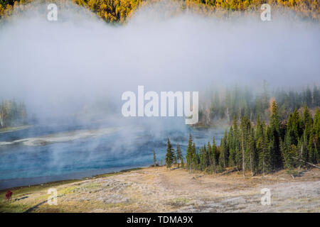 A river shrouded in fog. - Stock Photo