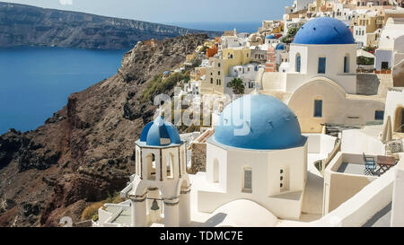 famous three blue church domes in oia, santorini - Stock Photo
