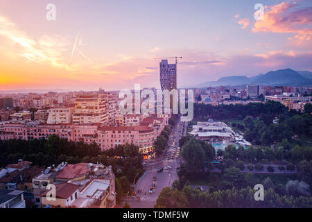 Areal view of Tirana city center at sunset. - Stock Photo