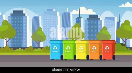 rubbish containers different types of recycling bins segregate waste sorting management environment protection concept modern cityscape background - Stock Photo
