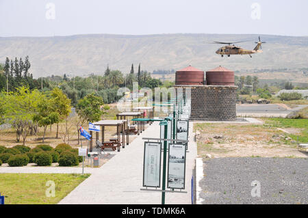 Israeli Air Force (IAF) helicopter, Sikorsky UH-60 Blackhawk (Yanshuf) in flight over the recently restored Ottoman railway station at Tzemach (Samakh - Stock Photo