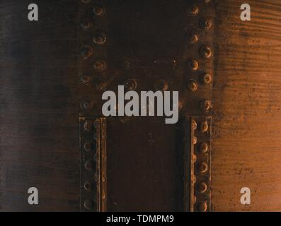A close up shot of a big rusty tank with bolt fixed with metal pieces - Stock Photo