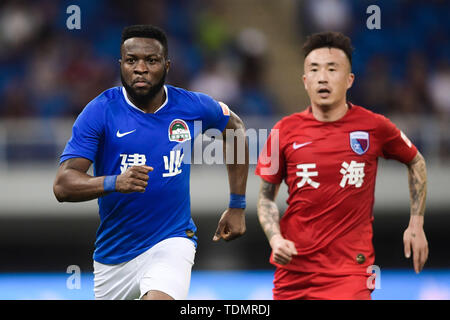 Cameroonian football player Franck Ohandza, left, of Henan Jianye reacts as he competes against Tianjin Tianhai in their 13th round match during the 2019 Chinese Football Association Super League (CSL) in Tianjin, China, 16 June 2019.  Tianjin Tianhai played draw to Henan Jianye 1-1. - Stock Photo