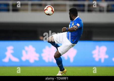 Cameroonian football player Franck Ohandza of Henan Jianye shots the ball against Tianjin Tianhai in their 13th round match during the 2019 Chinese Football Association Super League (CSL) in Tianjin, China, 16 June 2019.  Tianjin Tianhai played draw to Henan Jianye 1-1. - Stock Photo