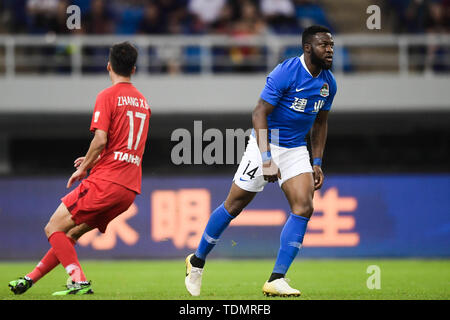 Cameroonian football player Franck Ohandza, right, of Henan Jianye celebrates after scoring against Tianjin Tianhai in their 13th round match during the 2019 Chinese Football Association Super League (CSL) in Tianjin, China, 16 June 2019.  Tianjin Tianhai played draw to Henan Jianye 1-1. - Stock Photo