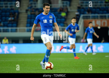 English-born Taiwanese football player Tim Chow of Henan Jianye dribbles against Tianjin Tianhai in their 13th round match during the 2019 Chinese Football Association Super League (CSL) in Tianjin, China, 16 June 2019.  Tianjin Tianhai played draw to Henan Jianye 1-1. - Stock Photo