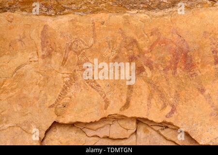 Neolithic rockart, rock painting of warriors or hunters, Abaniora style, bovidian period, Tassili n'Ajjer National Park, Sahara, Algeria - Stock Photo