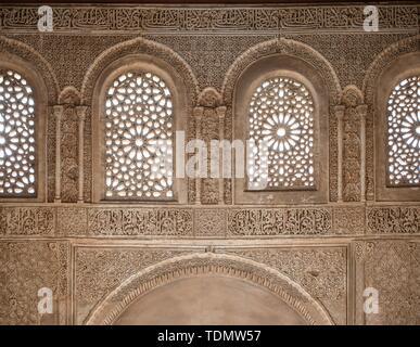 Wall with ornamental plaster decorations, Summer Palace, Palacio de Generalife, Alhambra, Granada, Spain - Stock Photo