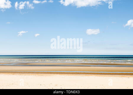 Minimalistic layered seascape with yellow, green and blue - Stock Photo