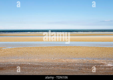 Minimalistic layered seascape with yellow, green and blue blue - Stock Photo