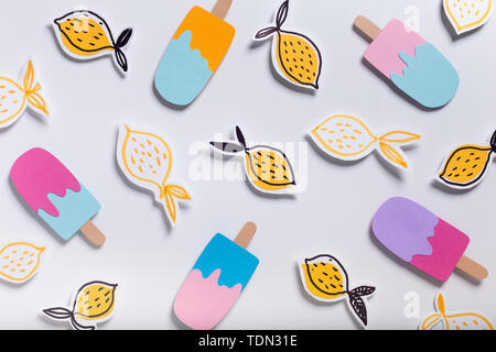 Creative summer background with ice cream and fresh lemons - Stock Photo
