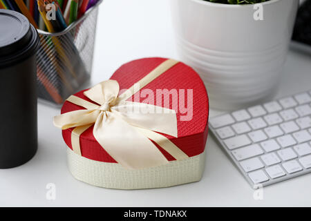 Heart box office table in vintage style - Stock Photo
