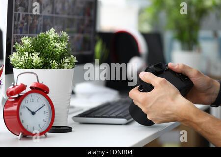 Hand photo camera office. Computer technology - Stock Photo