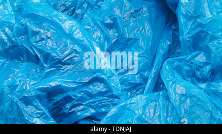 Blue Plastic Bag Texture. Abstract Wrinkled Background of Plastic Garbage