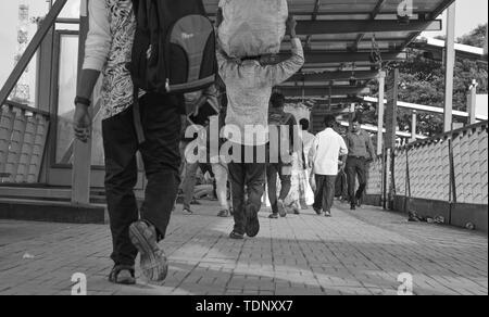 BANGALORE INDIA June 2, 2019 :Low view ange of a People walking at Bengalore Bus station, Karnataka - Stock Photo
