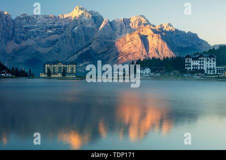 The Marmarole and Sorapiss Groups of the Dolomites at first light tower over Lago Misurina, Belluno, Veneto, Italy - Stock Photo