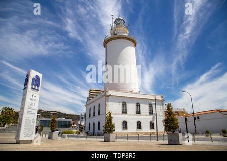 Malaga, Spain - May 24, 2019: Exterior view of the white lighthouse La Farola de Malaga. - Stock Photo
