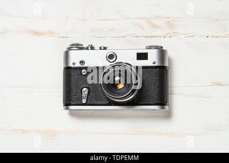 Old film camera on white background.