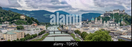 Panoramic view of the Salzburg Cityscape, with the Salzach river the center and Hochensalzburg Fortress on top of the Hill on the right upper side. Ph - Stock Photo