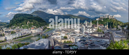 Panoramic view of the Salzburg Cityscape, with the Salzach river on the left and Hochensalzburg Fortress on top of the Hill on the right upper side. P - Stock Photo