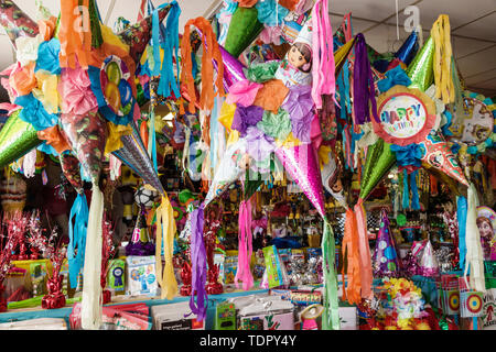 Florida Immokalee Mimi's Pinatas & Party Rentals inside party supply store colorful display sale - Stock Photo