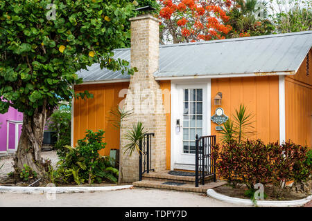 Captiva Island Florida 'Tween Waters Inn Island Resort & Spa hotel guest cottage exterior chimney tropical foliage - Stock Photo