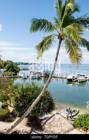 Captiva Island Florida 'Tween Waters Inn Island Resort & Spa hotel marina docks boats waterfront palm tree Pine Island Sound - Stock Photo
