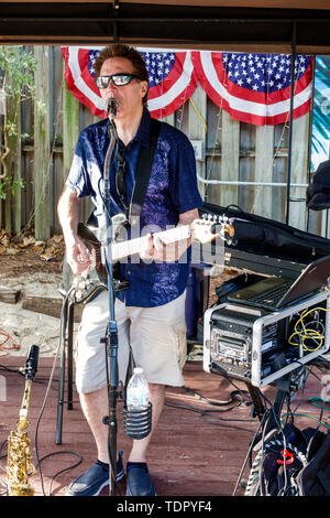 Captiva Island Florida The Mucky Duck restaurant outdoor bar man musician playing guitar singing entertainer - Stock Photo