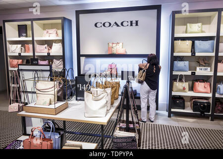 Fort Ft. Myers Florida Sanibel Outlets Outlet Mall shopping Coach luxury accessories leather goods inside sale display handbags woman - Stock Photo