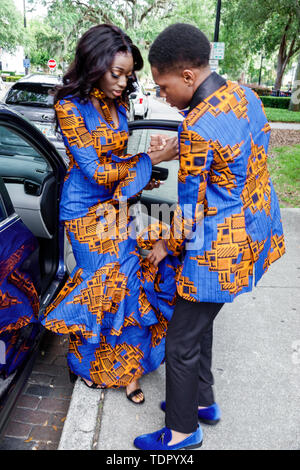 Orlando Florida Lake Eola Park high school prom fashion fashionable Black boy girl student teen couple date African-inspired textile print design tuxe - Stock Photo