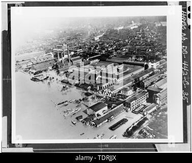Photographic copy of an historic photograph (From the Navy Yard Historical Center). AERIAL VIEW OF THE NAVY YARD DURING THE 1936 FLOOD. VIEW LOOKING NORTHWEST. BUILDING 36, JUST RIGHT OF CENTER, CONSISTS OF THE EAST AND NORTH WINGS OF THE QUADRANGLE STRUCTURE. - Navy Yard, Ordnance Building, Intersection of Paulding and Kennon Streets, Washington, District of Columbia, DC - Stock Photo