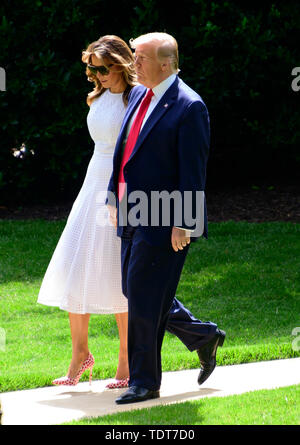 Washington, United States Of America. 18th June, 2019. United States President Donald J. Trump and first lady Melania Trump walk from the Oval Office as they prepare to depart the South Lawn of the White House in Washington, DC for Orlando Florida where the President will formally announce he is a candidate for re-election on Tuesday. June 18, 2019. Credit: Ron Sachs/CNP | usage worldwide Credit: dpa/Alamy Live News - Stock Photo