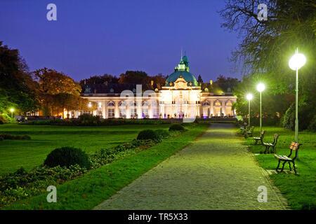 illuminated Kaiserpalais in the spa park at blue hour, Germany, North Rhine-Westphalia, East Westphalia, Bad Oeynhausen - Stock Photo