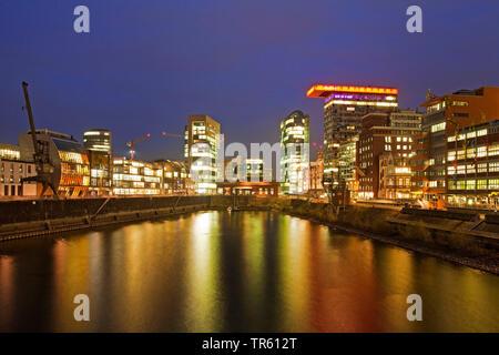 Medienhafen in Duesseldorf at night, Germany, North Rhine-Westphalia, Duesseldorf - Stock Photo