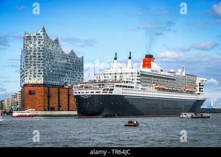 cruiser Queen Mary II and Elbphilharmonie in port of Hamburg, Germany, Hamburg - Stock Photo
