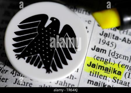 mit Leuchtstift markierter Eintrag Jamaika im Woerterbuch und deutscher Bundesadler, Symbolfoto Jamaika-Koalition, Deutschland   word Jamaika in a ger - Stock Photo