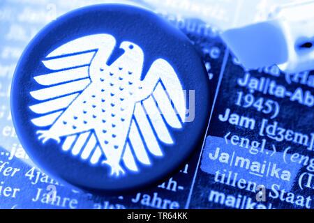 Eintrag Jamaika im Woerterbuch und deutscher Bundesadler, Symbolfoto Jamaika-Koalition, Deutschland   word Jamaika in a german dictionary, Germany   B - Stock Photo