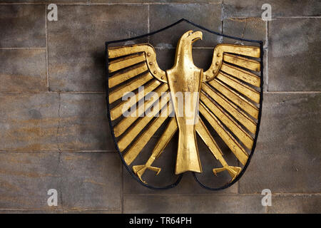 left-looking federal eagle at one of the entrance wall to Hammerschmidt Villa in Bonn, Germany, North Rhine-Westphalia, Bonn - Stock Photo