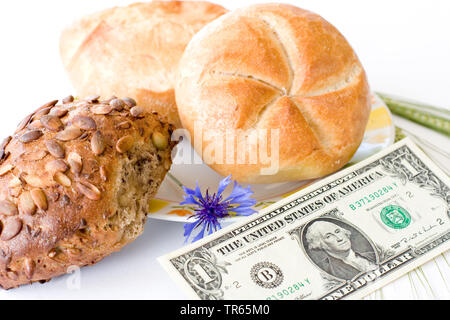 bread roll s with 1 dollar bill, cornflower and barley, USA - Stock Photo