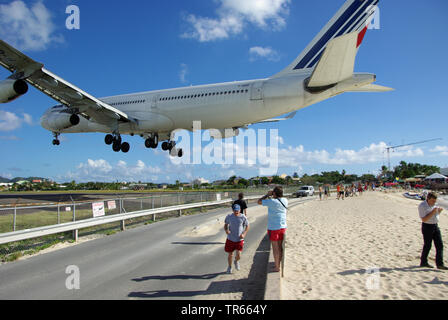 personas watching landing airplane, Guadeloupe - Stock Photo