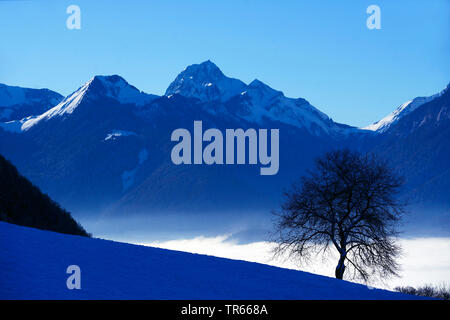 view from Col de la Forclaz over the Lake Annecy to the Bauges mountains in winter, France, Savoie, Haute Savoy - Stock Photo