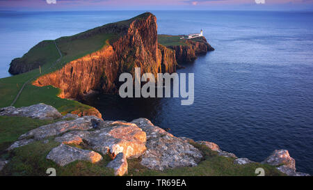 lighthouse at Neist Point at sunset, United Kingdom, Scotland, Isle of Skye - Stock Photo