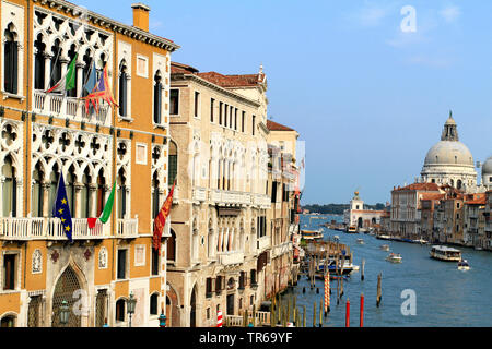 Palazzo Cavalli-Franchetti on the Grand Canal, church Santa Maria della Salute in background, Italy, Venice - Stock Photo