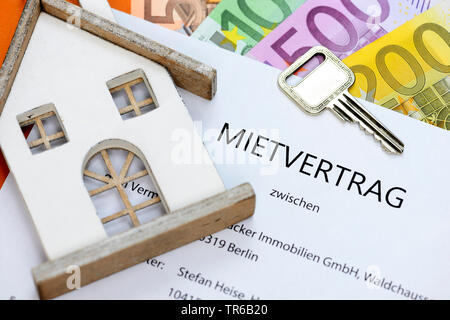 rental agreement with keys and Euro bill, Germany, Berlin - Stock Photo
