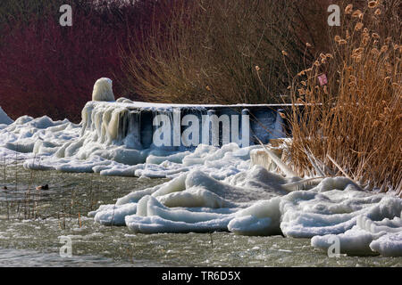 ice waves and ice sculptures on the shore after winter storm, Germany, Bavaria, Lake Chiemsee - Stock Photo