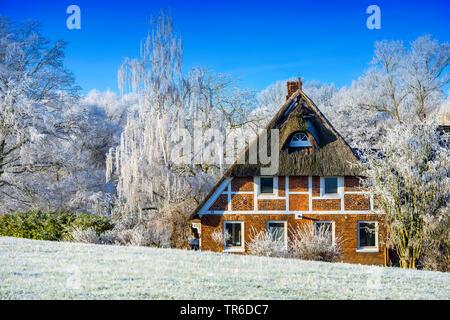 timbered house in winter in Kirchwerder, Germany, Hamburg, Vier- und Marschlande - Stock Photo